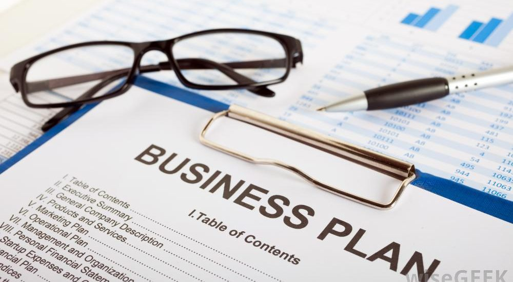 business-plan-with-glasses-and-pen